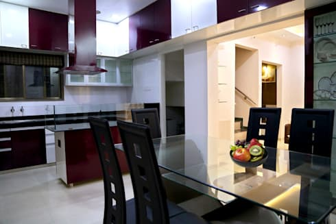 Dining with Kitchen: modern Dining room by ZEAL Arch Designs