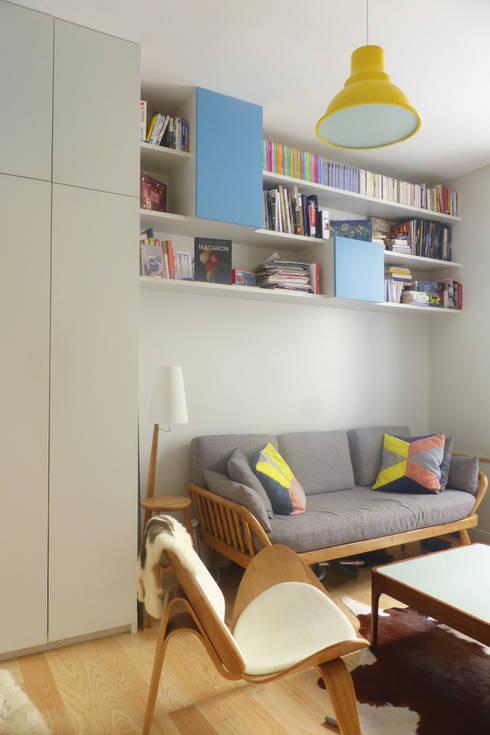 François - Appartement de 35 m2 optimisé: Salon de style  par Batiik Studio