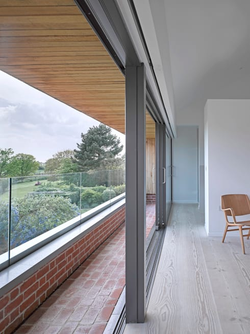 The master bedroom at the house at Broad Street in Suffolk:  Bedroom by Nash Baker Architects Ltd