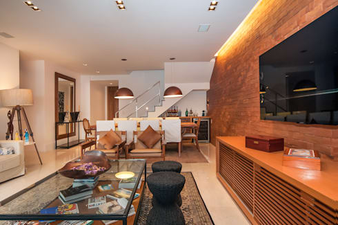 Av. Lúcio Costa: Salas de estar modernas por Alê Amado Arquitetura