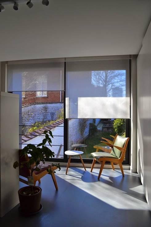 Rénovation maison Bruxelles: Bureau de style  par Metaforma Architettura