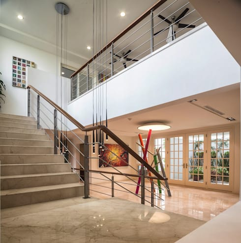 Recibidor y escaleras: Pasillos y recibidores de estilo  por ARQUITECTURA EN PROCESO