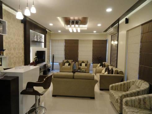 Amanora: modern Living room by MAVERICK Architects
