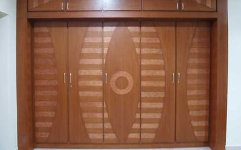 cupboards: modern Bedroom by CRYSTAL INTERIORS & FURNISHINGS