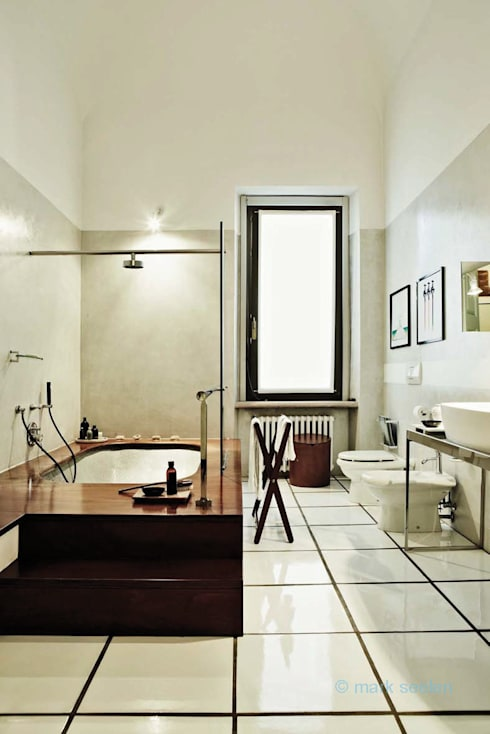 Casa Teresa: Bagno in stile  di Benedini & Partners