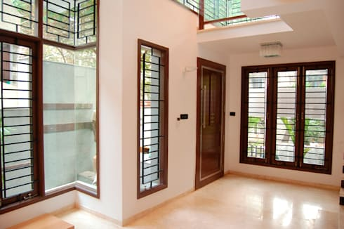 House of Dr. Hariharan: modern Living room by  Murali architects