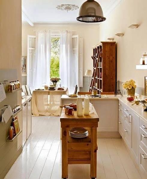 Proyectos de interiorismo varios : Cocinas de estilo  por estudio 60/75