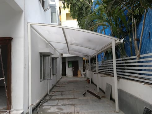 Poly carbonate sheet car parking by fabritech india homify for Terrace shed ideas