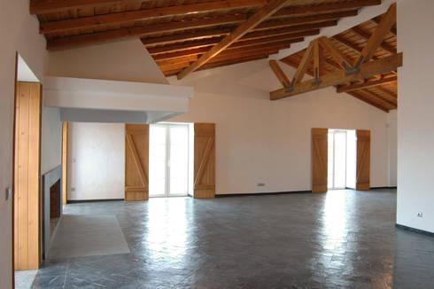 Habitação.Monte Alentejano I.Arraiolos: Salas de estar rústicas por BL Design Arquitectura e Interiores