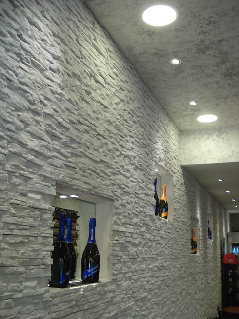 Office spaces & stores  by Rinnovare con la pietra