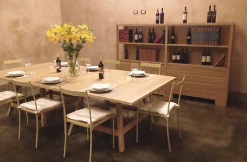 Arredamento per un ristorante cantina di build design for Arredamento cantina