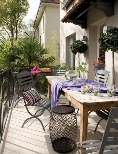 Duplex familiar  : Terrazas de estilo  de Estudio de Arquitectura Teresa Sapey