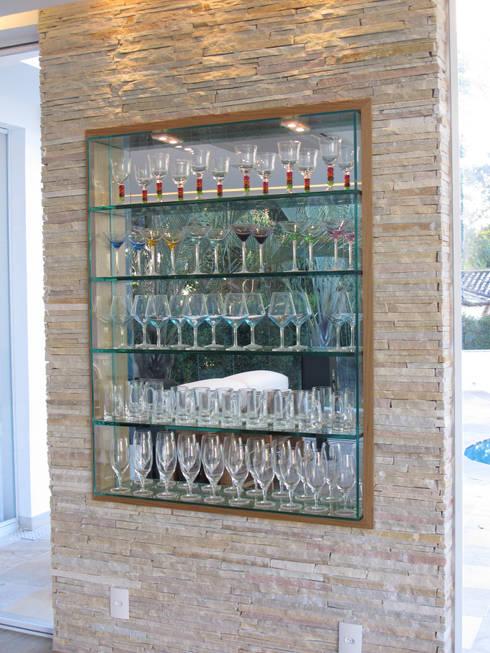 modern Wine cellar by Escritório Ana Meirelles
