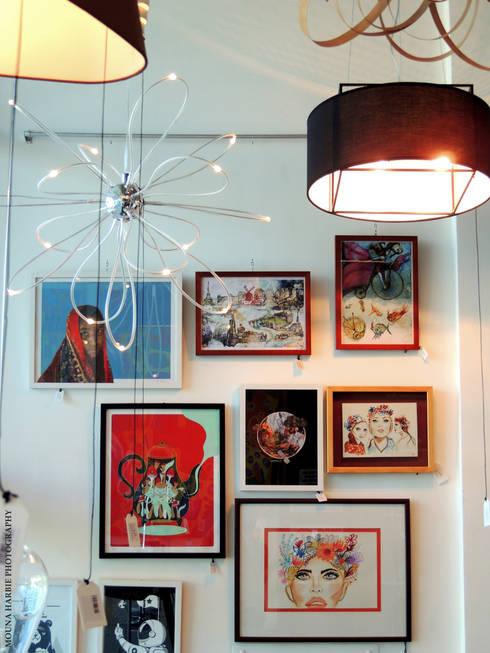 Area Obras de Arte: Tiendas y espacios comerciales de estilo  por RL+N Arquitectura