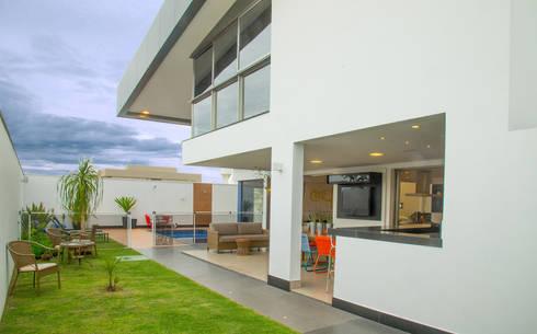 Casa AE: Jardins modernos por Arquitetura 1