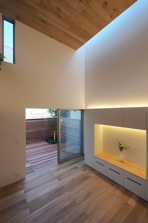 Salas de estilo  por アトリエ スピノザ