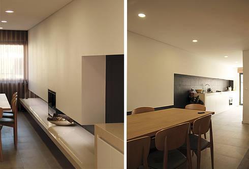 Casa na Póvoa de Varzim: Salas de jantar modernas por ASVS Arquitectos Associados