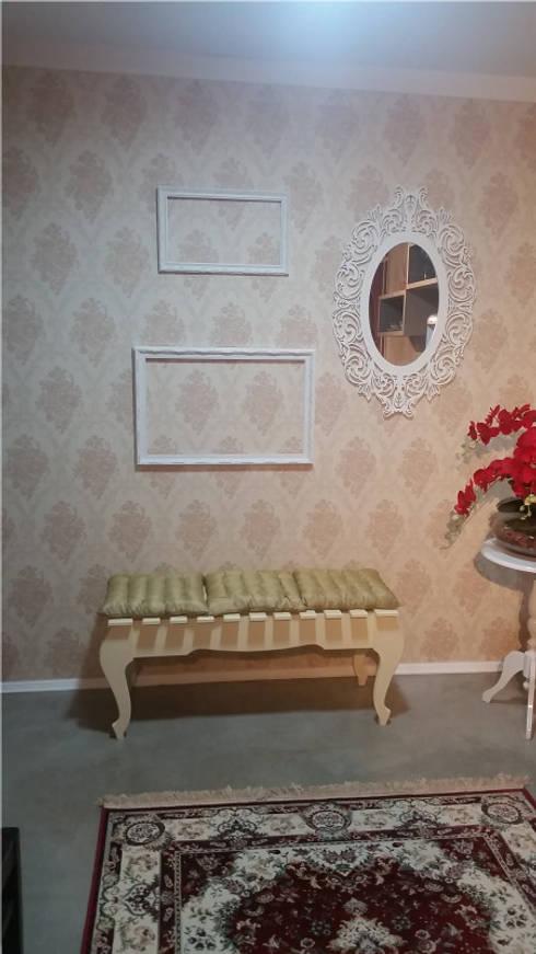 ALDORA Moda Branco - Detalhe Área de espera Loja: Escritório e loja  por Clara Vicente Arquitetura