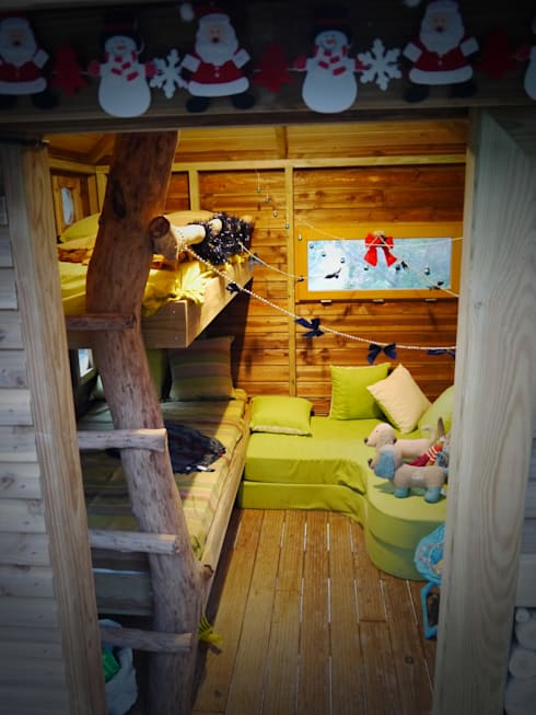 Une chambre dans les arbres: Chambre d'enfant de style  par Cabaneo
