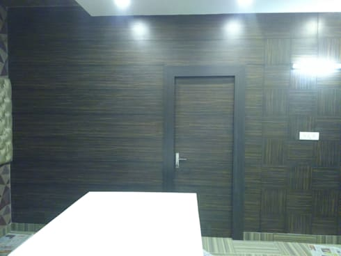 Laminated Partition :  Walls & flooring by Studio Interiors Infra Height Pvt Ltd