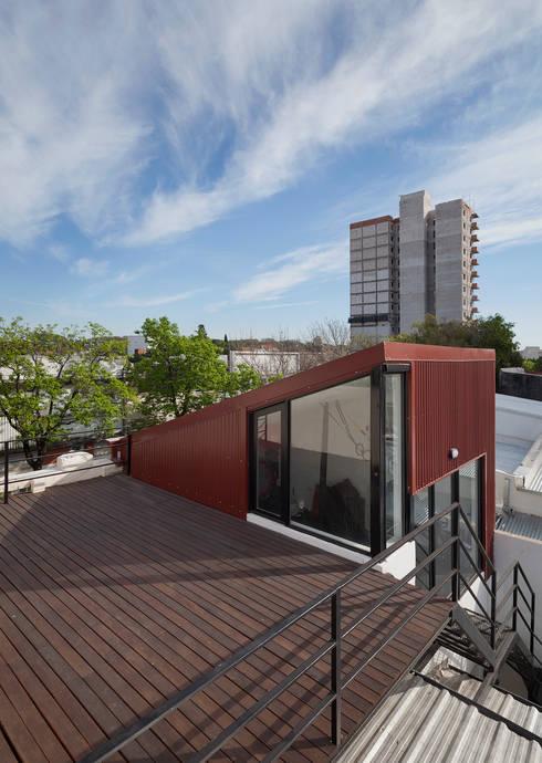 Gimnasios domésticos de estilo industrial de Paschetta&Cavallero Arquitectos