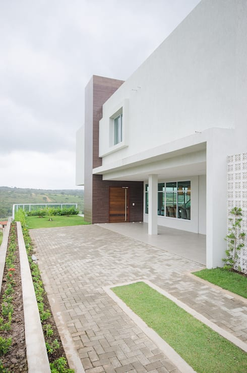 Fachada: Casas modernas por Fábrica Arquitetura