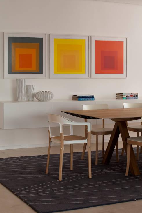 Apartamento Vila Nova Conceição 2: Salas de jantar modernas por Antônio Ferreira Junior e Mário Celso Bernardes