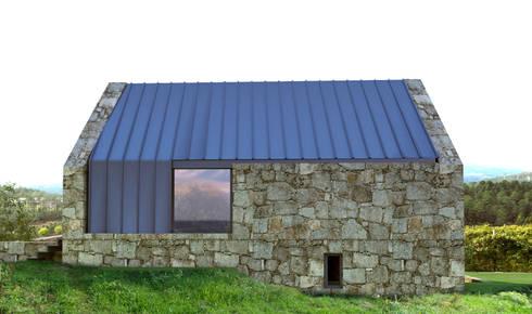 Alçado posterior: Casas rústicas por Davide Domingues Arquitecto