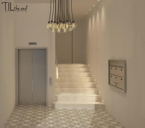 Residential Building in Lisbon: Corredores e halls de entrada  por Lagom studio