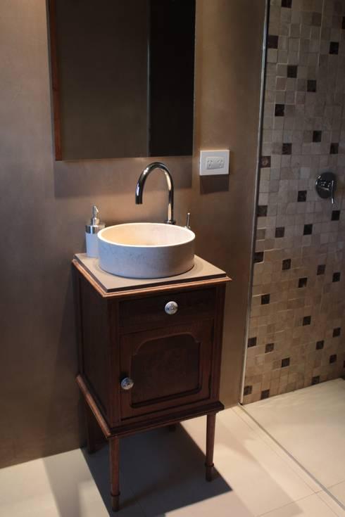 CASA MJM: Baños de estilo minimalista por JORGELINA ALVAREZ  I arquitecta I