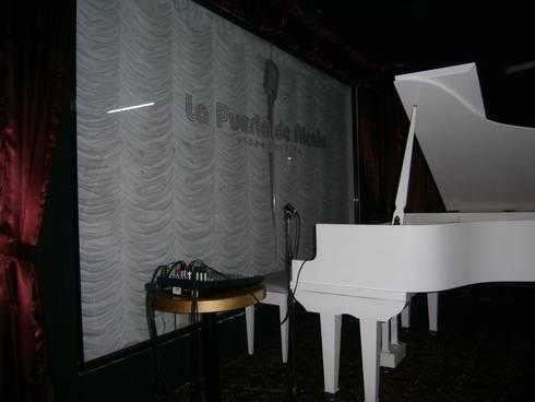 Piano: Bares y discotecas de estilo  por AQ3 Arquitectos