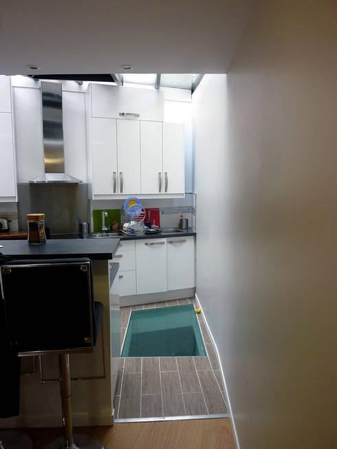 Extensions d'une maison individuelle : Cuisine de style de style Moderne par Olivier Stadler Architecte