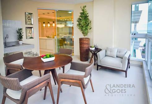 Apartamento Decorado – Itapema/SC: Terraços  por Landeira & Goes Arquitetura
