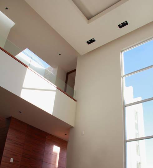 SALA: Salas de estilo moderno por GRUPO VOLTA