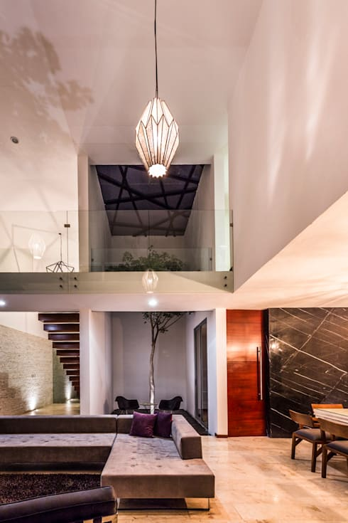 La Casa K27: Salas de estilo moderno por P11 ARQUITECTOS