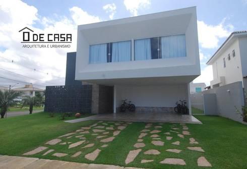 Alphaville litoral norte I: Casas modernas por ô de casa - arquitetura e light design