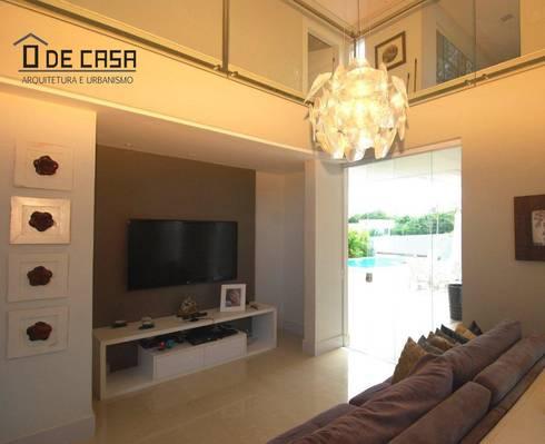 Alphaville litoral norte I: Salas de estar modernas por ô de casa - arquitetura e light design