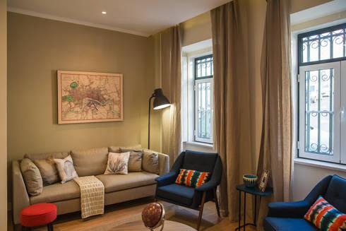 Um look contemporâneo e cosmopolita: Salas de estar modernas por Architect Your Home