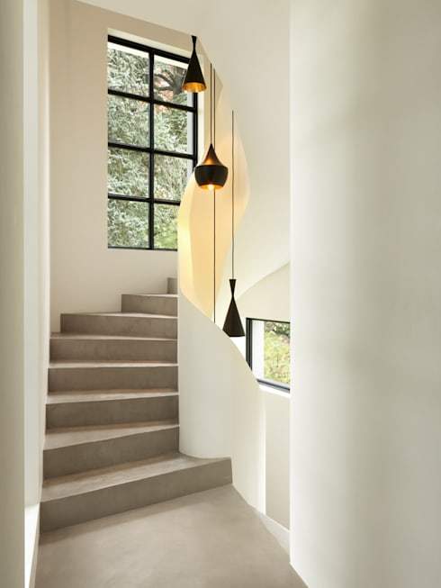 Villa Genève: Couloir et hall d'entrée de style  par Peter Kammermann Décorateur