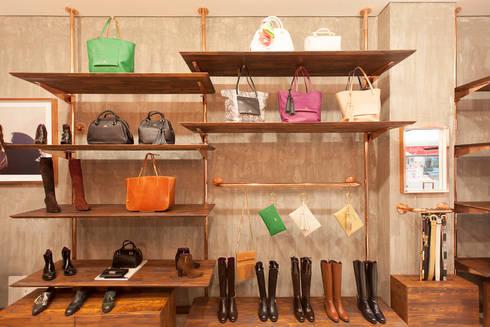 Nora Lozza – Andino: Espacios comerciales de estilo  por ODA - Oficina de Diseño y Arquitectura