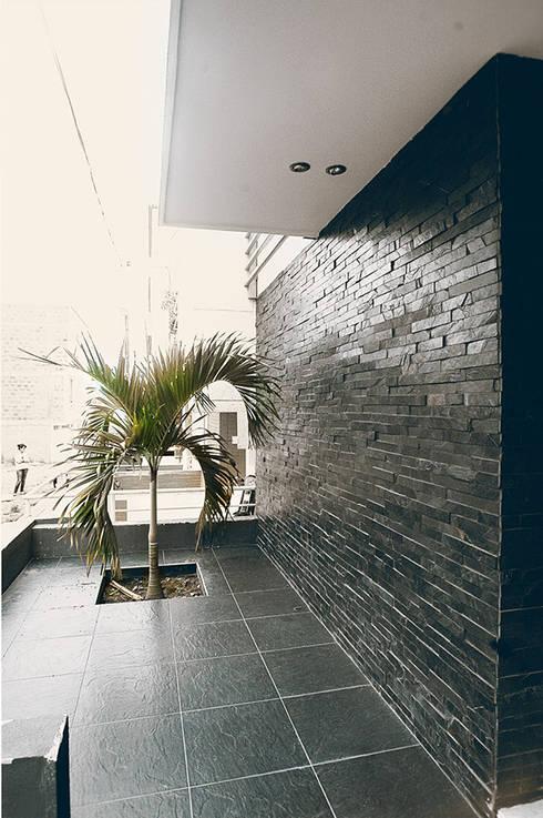 Casas de estilo  por Oficina Suramericana De Arquitectura
