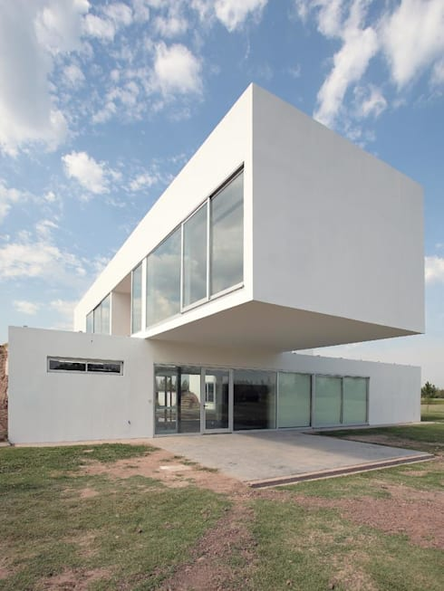 Houses by Estudio Arquitecta Mariel Suarez