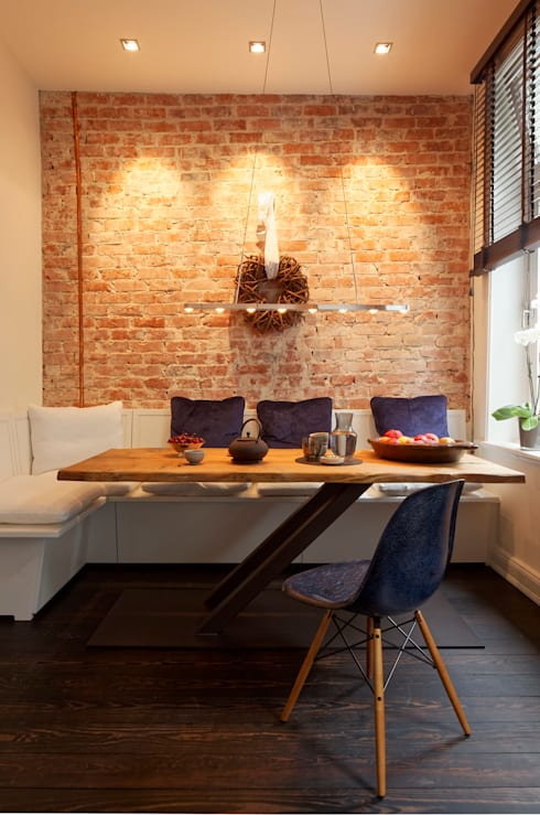 rustic Dining room by WEINKATH GmbH
