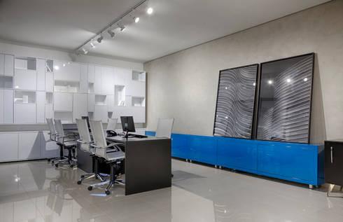Idelli : Espaços comerciais  por Piacesi Arquitetos
