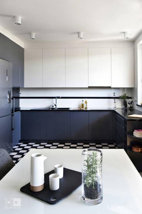 Realizacja projektu mieszkania / Warszawa: styl , w kategorii Kuchnia zaprojektowany przez Hubert Dziedzic Architektura Wnętrz