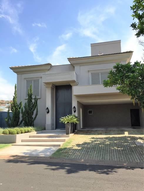 Residencia Tarraf - Condominio Harmonia: Casas  por FERNANDO ROMA . estudioROMA