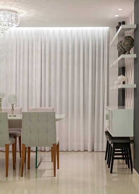 Apartamento Jovem Casal: Salas de jantar modernas por Laura Santos Design