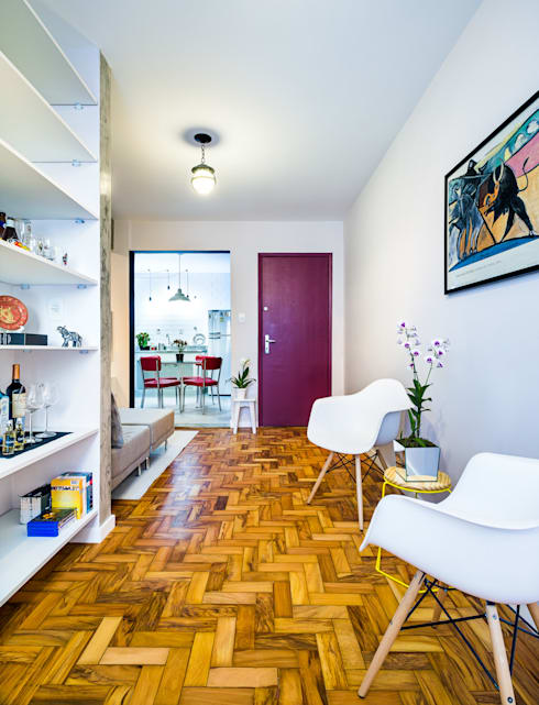 Sala de estar e biblioteca: Salas de estar modernas por Studio ML