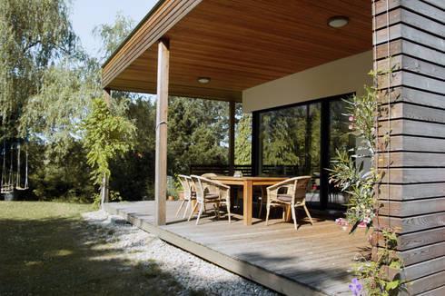 einfamilienhaus am hang von architekt stefan toifl homify. Black Bedroom Furniture Sets. Home Design Ideas