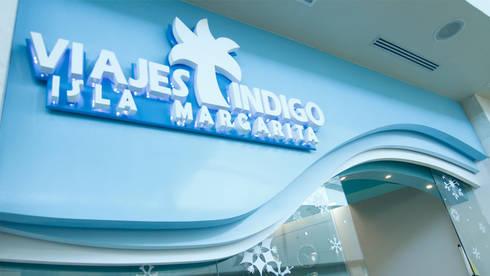 Viajes Indigo: Espacios comerciales de estilo  por NOGARQ C.A.